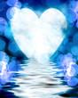 Heart shaped moon reflected in ocean