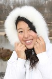 Chinese winter girl wearing white coat