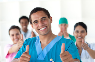 Attractive doctor with thumbs up