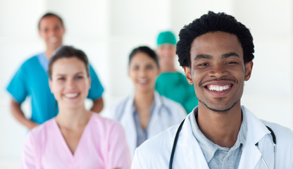 Multi-ethnic medical people smiling at the camera