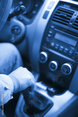 the interior of a car. man driving on the road.