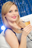 Woman in nightclub drinking champagne poster