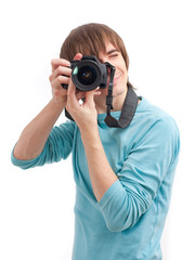 Young man making photo. Front view