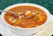 closeup beef barley soup with a spoonful