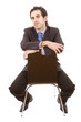 business man portrait sitting on a chair - isolated over a white