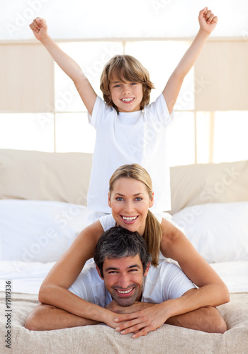 Happy boy playing with his parents