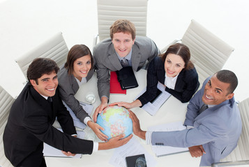 High angle of a diverse business team holding a terrestrial glob