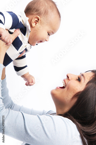 Mother lifting happy smiling baby