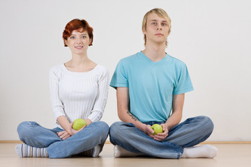 Couple sitting on floor