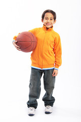 Young boy holding basketball isolated