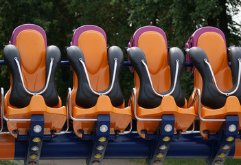 It is black - orange armchairs of an attraction