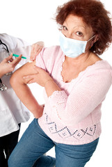 Senior woman getting flu vaccine
