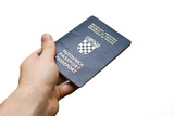 A hand holding a Croatian Passport, isolated on white. poster