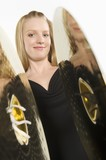 Young woman plays the cymbals