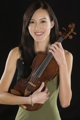 Portrait of female Asian violinist