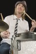 Young man plays the drums