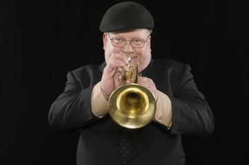 Mature man playing the trumpet