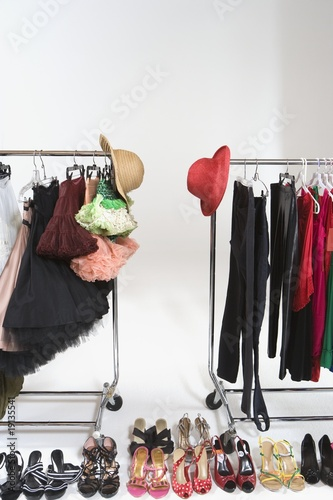 Fashion hats and accessories on clothes rail