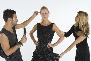Stylists attend to model