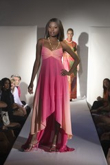 Woman in pink dress on fashion catwalk