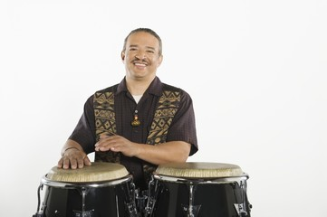 Hispanic bongo drum player