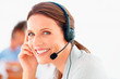 Closeup of a happy young customer representative wearing headset