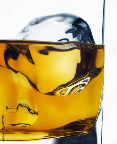 ice cube melting in whiskey