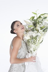 Woman accepts a bouquet of white flowers
