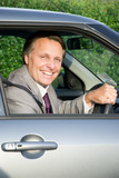 Happy smiling forties man driving car. poster