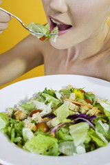 A Young Woman Eating Salad