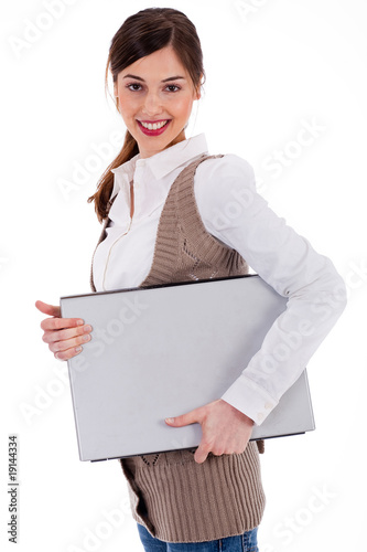young womencarrying a laptop