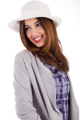 Young model with spring clothing and white hat