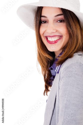 Smiling brunette model side pose