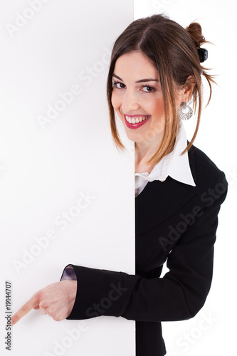 Business women smiling and pointing a blank board