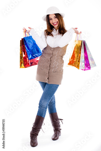 Young girl happy with lot of shopping bags