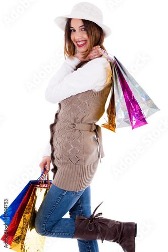 young women enjoyed shopping and carrying her bags