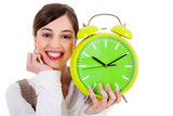 attractive young model smiling and holding the clock