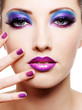Beautiful female face with purple glamour make-up
