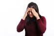 Woman suffering a migraine headache
