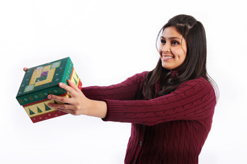 Happy young woman giving gift