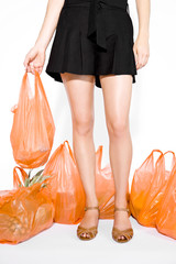 A Young Woman Surrounded By Shopping Bags