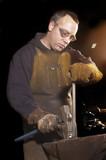 Blacksmith working on decorative handrail poster