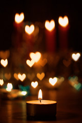 Candles and heartshaped bokeh