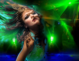 Beautiful young woman dancing in the nightclub. poster