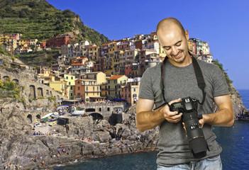 smiling photographer in cinque terre italy