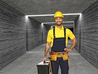 manual worker in concrete tunnel background