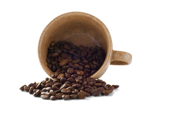 Brown isolated cup with cofee beans poured from it