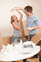 Moving house: Man and woman having fun