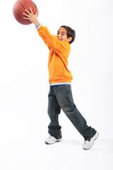 Child having fun with basketball