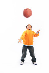 Boy throwing basketball up in the air
